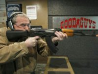 A man fires an AK-47 with a bump stock installed at Good Guys Gun and Range on February 21, 2018 in Orem, Utah