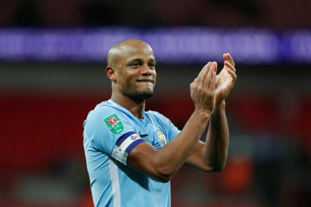 Manchester City's defender Vincent Kompany celebrates on the pitch after the English League Cup final football match against Arsenal February 25, 2018