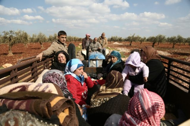 Syrian civilians flee Afrin after Turkey said its army and allied rebels surrounded the Kurdish city in northern Syria on March 13, 2018