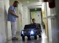 A two-year-old happily drives his way to the operating room at a hospital in Valenciennes in northern France