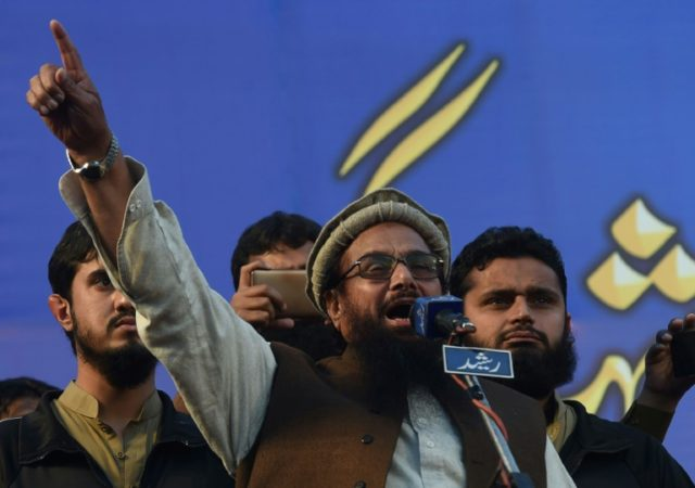 "Hafiz Saeed (C) head of the Lashkar-e-Tayyiba (LeT) militant group, speaks in Lahore last month; a US official has said Pakistan is doing the ""bare minimum"" to squeeze the Taliban and terror groups"