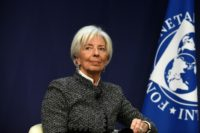 International Monetary Fund Managing Director Christine Lagarde called on member countries to resist protectionism and reduce economic risks by enacting reforms and cutting debt levels