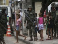 Brazilian Army soldiers patrol during a permanent operation at Vila Kennedy favela in Rio de Janeiro, Brazil, on March 17, 2018