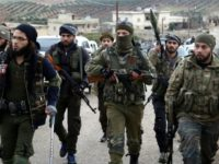 Turkish-backed Syrian rebels enter the village of Qastal Koshk, north of Afrin, on March 16, 2018 following battles with Kurdish fighters