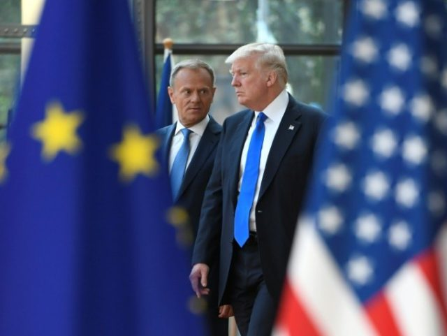 European Council President Donald Tusk (L) speaks to US President Donald Trump (R) as he welcomes him at EU headquarters, as part of the NATO meeting, in Brussels, on May 25, 2017