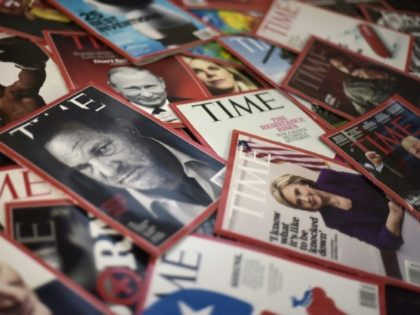 Time magazine copies are dispalyed on a table in Washgington on November 27, 2017. Time Inc. is selling for $2.8 billion to media conglomerate Meredith Corporation, which is backed by the billionaire Koch brothers, who are known for supporting conservative causes. Time, which also publishes its eponymous magazine, Fortune, and …