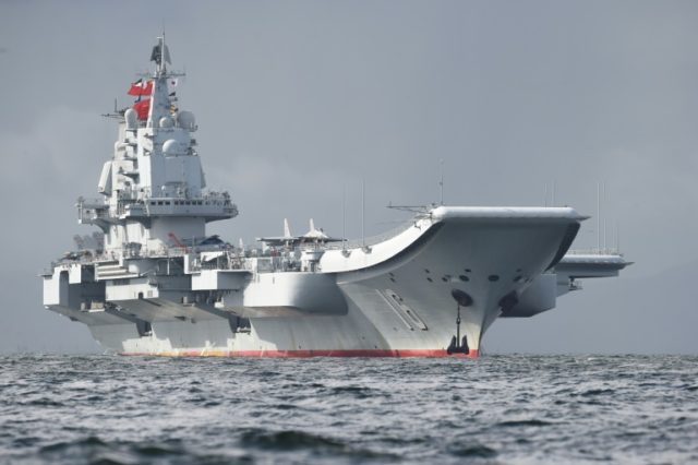 China's aircraft carrier sails past Taiwan as tensions rise