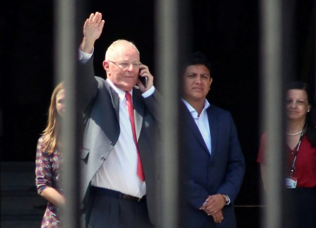 Peru's President Pedro Pablo Kuczynski leaves the government palace in Lima, after recording a televised message announcing his resignation