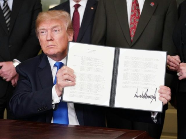 "In what he called ""the first of many"" trade actions, President Donald Trump signed an order imposing tariffs on at least $50 billion in Chinese products, and looking at restrictions on Chinese investments in the US"