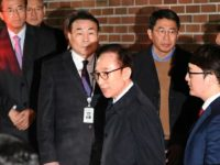 Former South Korean president Lee Myung-bak leaving his house for a police station where he was arrested
