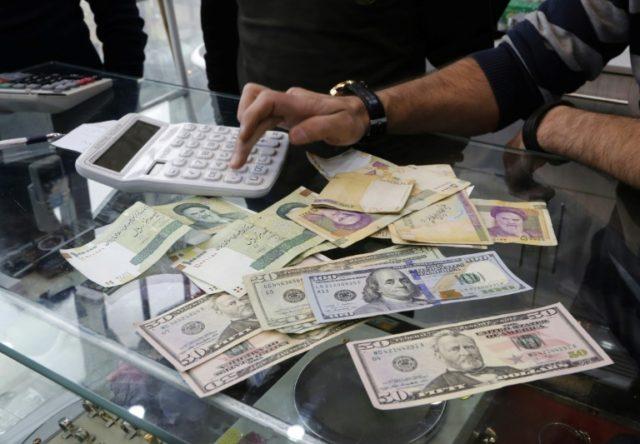 Iran currency hits record low, crashing through 50,000 mark
