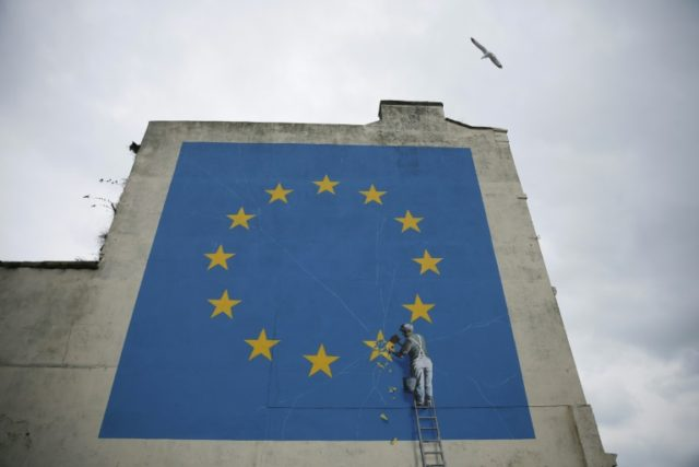A mural by British artist Banksy in Dover represents the UK's divorce from the EU
