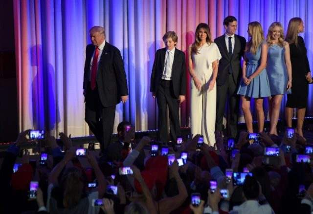 This file photo taken on November 8, 2016 shows president-elect Donald Trump walking with his family to the podium to speak during election night in New York