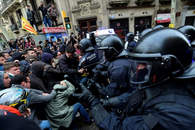 Protesters scuffle with riot police at a demonstration in Barcelona Sunday as analysts say the pro-independence movement is at risk of becoming radicalised