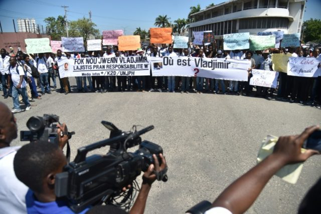 More than 200 people marched in solidarity with missing journalist Vladjimir Legagneur in Port-au-Prince