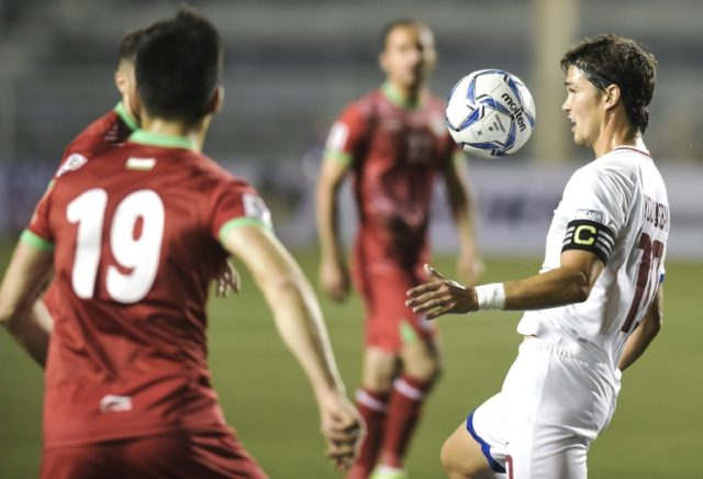 Captain Phil Younghusband (right) of the Philippines controls the ball against Tajikistan during in the AFC Asian Cup 2019 qualifier at the Rizal Memorial stadium in Manila. Philippines won 2-1 to book their place in the continental showpiece for the first time