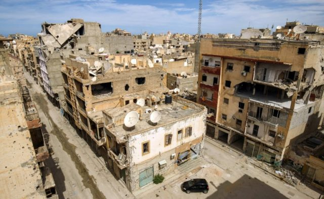 A picture taken on March 13, 2018 shows a general view of destroyed buildings in a central district in the eastern Libyan city of Benghazi.