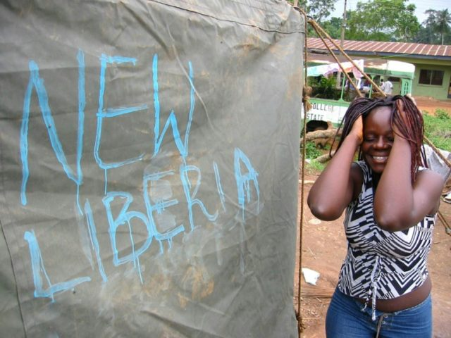 Burden of war: Thousands of displaced people sheltered in tent camps during Liberia's bloody civil conflict (2003 file picture)