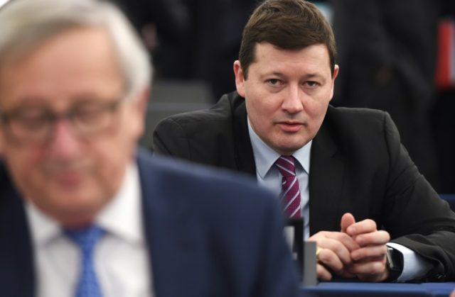 General Secretary of the European Commission Martin Selmayr, pictured lying in wait behind his boss Jean-Claude Juncker on March 13, 2018, rankled MEPs with his swift promotion