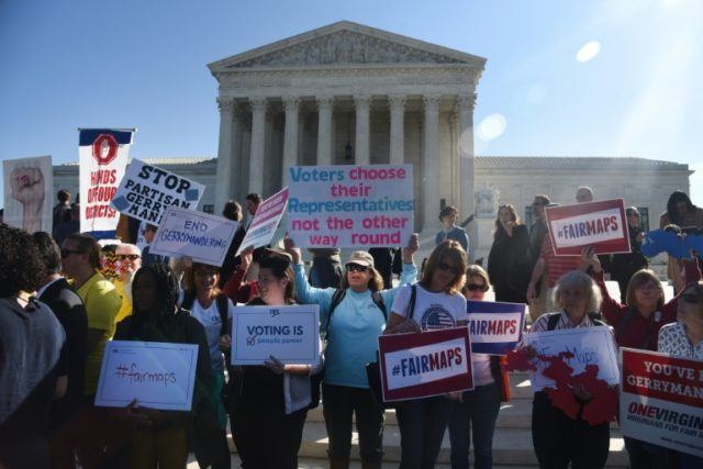 Demonstrators gather outside The United States Supreme Court on October 3, 2017 to call for an end to partisan gerrymandering