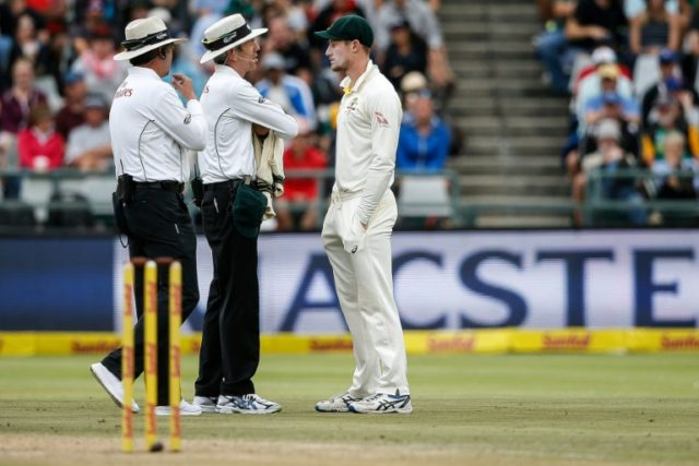 Australian batsman Cameron Bancroft is questioned by the umpires during the Test at Newlands