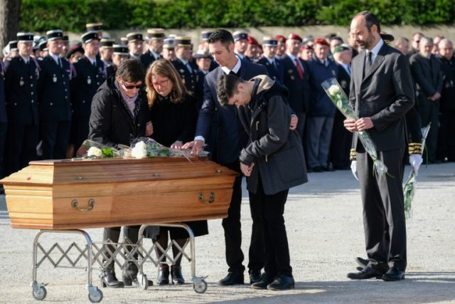 French premier Edouard Philippe (R) was present as family members paid their last respects at a funeral service for the three people killed in a terrorist attack in the town of Trebes on March 29