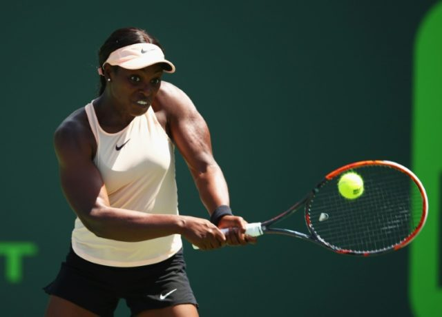 Sloane Stephens of the United States returns a backhand against Victoria Azarenka of Belarus in their semifinal match during the Miami Open at Crandon Park Tennis Center in Key Biscayne, Florida
