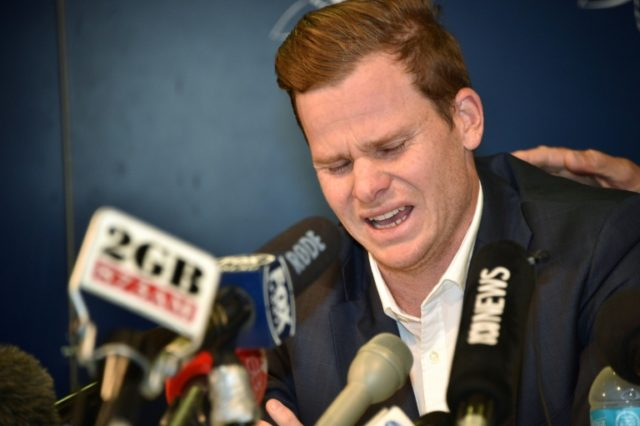 Cricketer Steve Smith apologises at a press conference at the airport in Sydney on March 29, 2018, after returning from South Africa