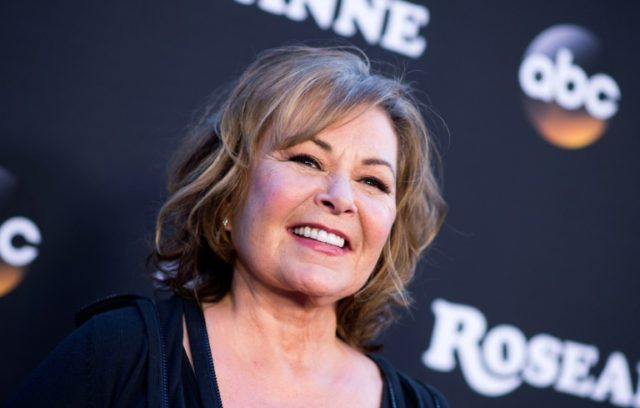 Roseanne Barr -- star and series creator of 'Roseanne' -- attends the premiere of her revived hit sitcom on March 23 at Walt Disney Studios in Burbank, California; so far, it's earning generally positive reviews