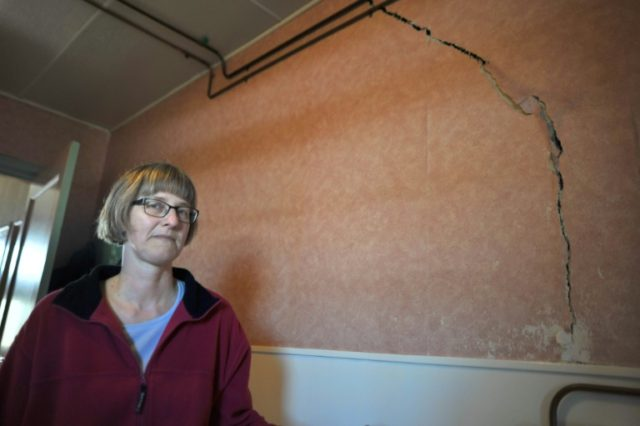 Dutch homeowner Martha Bos in 2013 after repeated earthquakes due to natural gas extraction caused a crack in a wall in her home located some 10 kilometres (six miles) from Groningen
