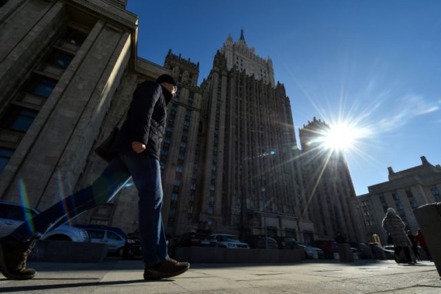 "A man walks past the Russian Foreign Ministry headquarters in Moscow on March 29, 2018. Russia is facing a ""global wave of revulsion"" in response to the nerve agent attack on a former Russian spy, Britain's Foreign Secreta"