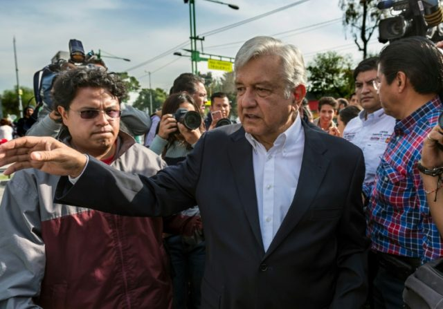 Mexican presidential frontrunner Andres Manuel Lopez Obrador is a fiery leftist who is making his third attemp for the country's highest office of MORENA party, greets supporters upon his arrival to the conmemoration of the 80th anniversary of Mexican Oil Expropiation in Mexico City on March 18, 2018. Mexico will …