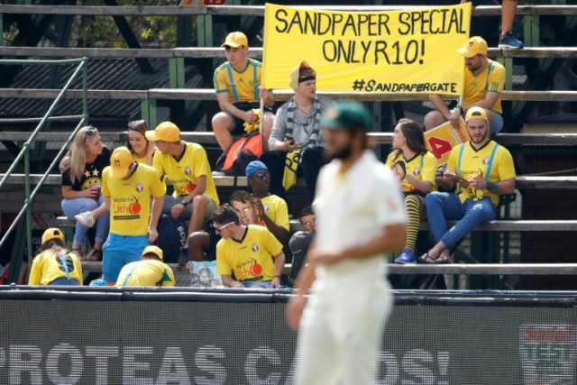 South African fans at the fourth Test at Wanderers Stadium in Johannesburg mock the Australian team's fateful attempts to tamper with the ball