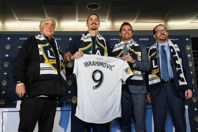 LA story: Zlatan Ibrahimovic holds up his new team shirt after signing for Los Angeles Galaxy