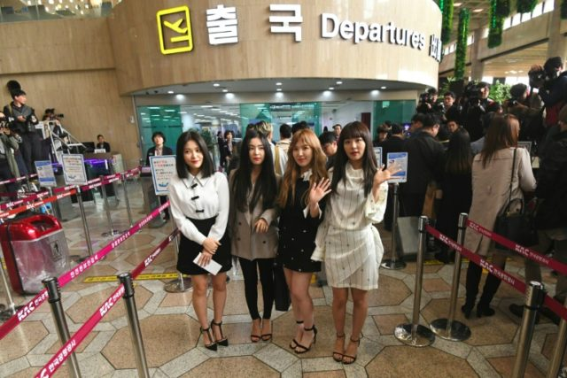 "Members of K-pop girlband ""Red Velvet"" pose for a photo before departing for Pyongyang from Gimpo International Airport in Seoul"