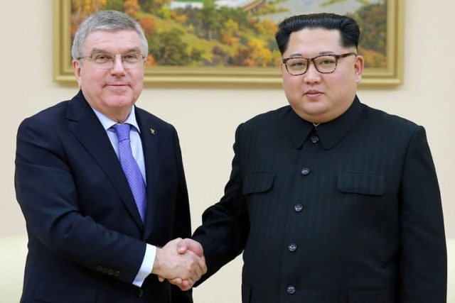 The two men held discussions about the development of sport in the North and attended a women's football match