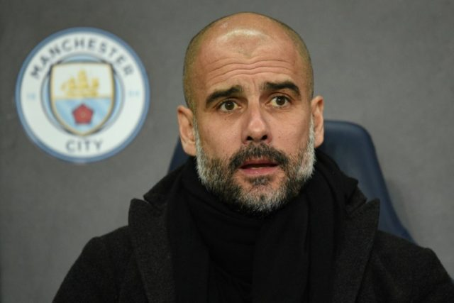 Manchester City's manager Pep Guardiola awaits kick off in the UEFA Champions League round of sixteen second leg football match against Basel March 7, 2018