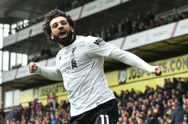 Dramatic winner: Liverpool's Egyptian star Mohamed Salah celebrates scoring the second goal