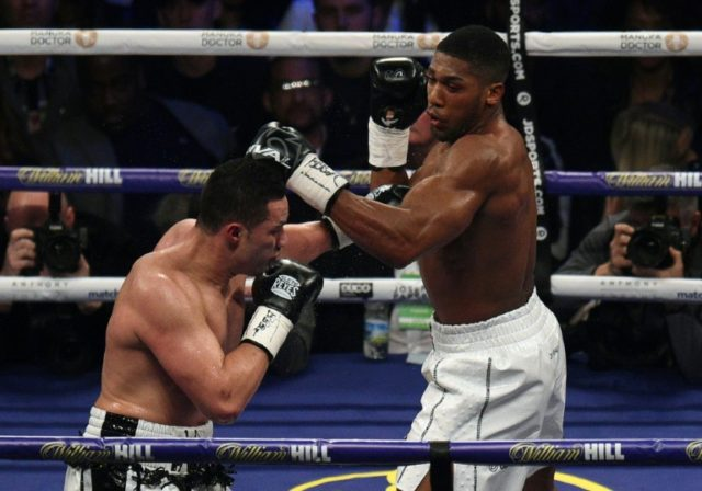 Joseph Parker (L) of New Zealand powers a left against Anthony Joshua (R) of Great Britain during their heavyweight unification bout at Principality Stadium in Cardiff, March 31, 2018