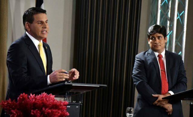 Costa Rican presidential candidates Fabricio Alvarado (L) and Carlos Alvarado participates in a debate in San Jose, Costa Rica