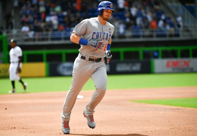 Ian Happ of the Chicago Cubs rounds the bases after hitting a lead off home run during Opening Day against the Miami Marlins in Miami, Florida