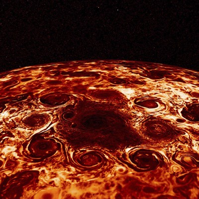 Geometric clusters of cyclones churn over Jupiter's poles