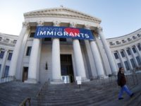 Immigrant Welcome Banner over steps of Denver City and County Building