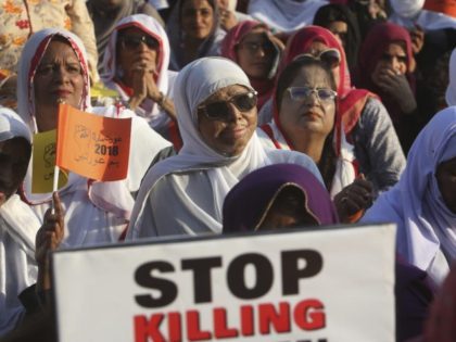 A Pakistani acid attack victim, center, takes part in a rally to mark International Women's Day in Karachi, Pakistan, Thursday, March 8, 2018. (AP Photo/Fareed Khan)