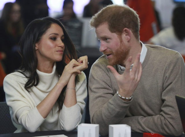 The Latest: Prince Harry and fiancee meet female students