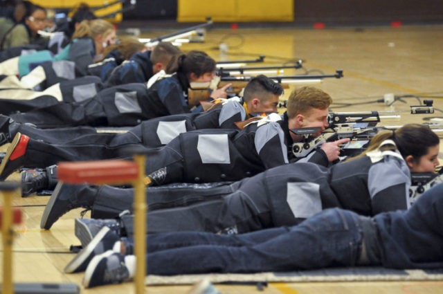 In this March 2, 2018 photo, a group of JROTC shooters compete in the prone position during the 2018 New Mexico Junior Olympic Qualifier for sport and precision air rifles at Cibola High School in Albuquerque, N.M., for the chance to compete at the National Junior Olympic Championships in Ohio …