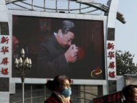 China Politics Hopes Dashed In this Nov. 16, 2017, photo, women walk by a TV screen showing a documentary footage of Chinese President Xi Jinping visiting a villager's house with a picture of late communist leader Mao Zedong, at the Beijing railway station in Beijing. Many Western scholars who studied …