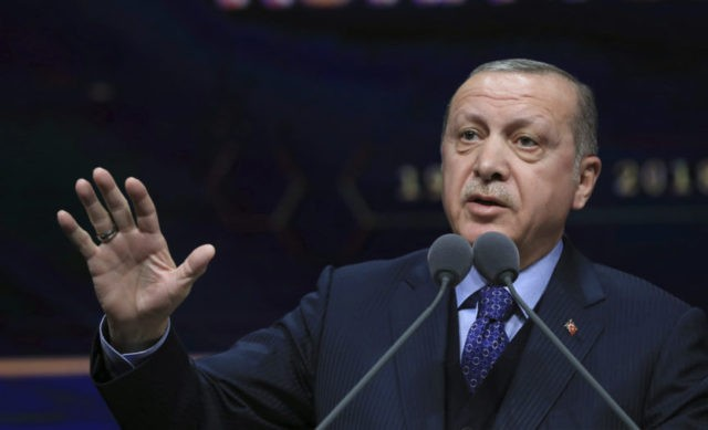 Turkey's President Recep Tayyip Erdogan speaks at a ceremony for judicial appointments in Ankara, Turkey, Monday, March 19, 2018. Erdogan says following victory in Syria's Afrin region, his country will expand its military operations into other Kurdish-held areas in Syria as well as in Iraq's Sinjar region.(Murat Cetinmuhurdar/Pool Photo via …
