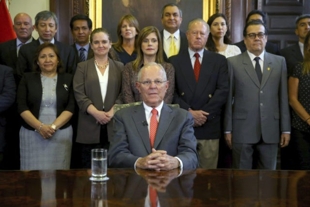 In this handout photo provided by the Peruvian Presidential Press Office, President Pedro Pablo Kuczynski poses with his cabinet before addressing the nation and announcing his resignation from office, Wednesday, March 21, 2018. The embattled Peruvian leader offered his resignation to Congress ahead of a scheduled vote on whether to …