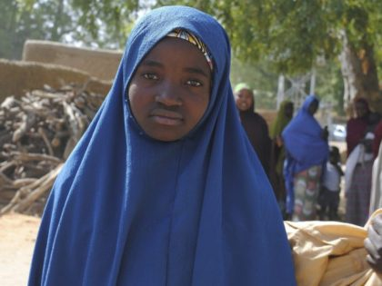 Aishat Alhaji , one of the kidnapped girls from the Government Girls Science and Technical College Dapchi who was freed, is photographed after her release, in Dapchi, Nigeria, Wednesday March. 21, 2018. Witnesses say Boko Haram militants have returned an unknown number of the 110 girls who were abducted from …